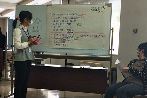Photo: A facilitator writing down participants' comments